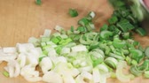 green onion : Spring onions being chopped