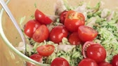 noodle dish : Cherry tomatoes being added to chicken and orzo pasta salad Stock Footage