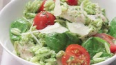 pasta dishes : Chicken and orzo salad sprinkled with freshly grated Parmesan Stock Footage