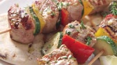 pimentas : Grilled meat and vegetable kebabs on pita bread