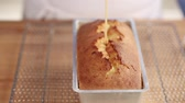 citrus fruit dish : Testing a loaf cake with a wooden stick Stock Footage