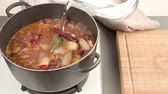 hotchpotches : Stifado being stirred and water being added
