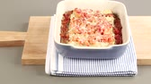 pasta dishes : Basil being scattered over gratinated cannelloni Stock Footage
