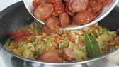 hotchpotches : Jambalaya being made: sliced sausages and prawns being added to a rice and vegetable stew