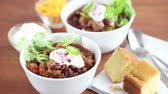 cream : Chilli con carne with sour cream and corn bread