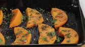 fruit slice : Spiced pumpkin wedges on a baking tray