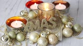 writing : Christmas decorations with tealights and golden baubles