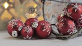 trimmings : Christmas baubles and burning candles in the backgrounds