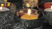 trimmings : A burning tealight with Christmas decorations
