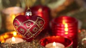 trimmings : A heart-shaped Christmas tree decoration and tealights