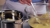 deepfry : Vegetables in chickpea batter being transferred to a pot of hot oil Stock Footage