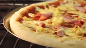 foods : A Hawaii pizza in an oven (time lapse) Stock Footage