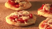 recipe : Mini pizzas being baked in a wood-fired oven (time lapse)