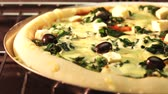 pizza cheese : A spinach, sheeps cheese and olive pizza in an oven (time lapse) Stock Footage