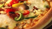 pizza cheese : A vegetarian pizza in an oven (close-up)