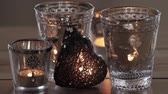 trimmings : Tea lights and a decorative heart Stock Footage