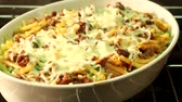 noodle dish : Macaroni bake in the oven time lapse Stock Footage