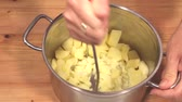 снег : Mashing Potatoes in a Pot