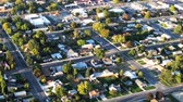 próximo : Aerial shot of neighborhood in Utah. Streets, homes and yards are visible. Filmed during the day.