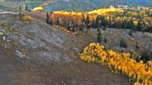 parkosított : Aerail view of Park City mountains and fall trees. Leaves are orange, red and rust color. FIlmed in Utah. Stock mozgókép