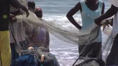 pescador : Medium close up shot of people on beach and fishing net