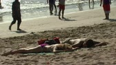 sexo : Wide shot of two people sunbathing Stock Footage
