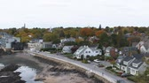 new house : Panning shot of a New England town with church spires showing above the colorful fall foliage in Marblehead, Massachusetts. Stock Footage