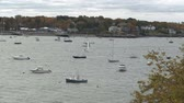 yat : Sailboats and motorboats at scattered moorings in Marblehead Harbor in Massachusetts.