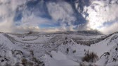 wintertime : Time-lapse fisheye shot of winter landscape at Utah valley with lens flare Stock Footage