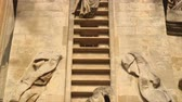 inglaterra : Tilt up shot of a sculpture of Jacobs ladder on a church in Bath, England