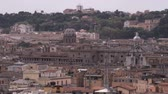 telha : A wide shot of the rooftops of Rome Italy.
