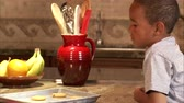 gastos : A close up dolly shot of a boy taking a cookie from a plate. Stock Footage