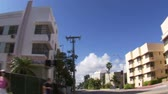 apartamentos : A trucking shot with a wide angle lens passing by apartments and hotels in Miami. Stock Footage