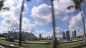 cruzeiro : A trucking shot with a wide angle lens on a Miami freeway with downtown in the background. Stock Footage