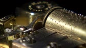 шестерня : A close up shot on black of the gears of a music box turning. Стоковые видеозаписи