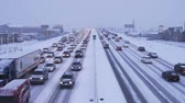 cuidado : Wide shot of traffic in winter storm