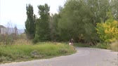 даты : A wide shot from behind as a couple walk down a path arm in arm.