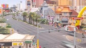 handbag : Timelapse of a Las Vegas intersection, with a large McDonalds, and the Casino Royale and the Ventian in the distance. Stock Footage
