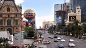 handbag : Timelapse of the busy Las Vegas Strip packed with tourists maneuvering on the sidewalk with the Ballys, Bellagio, Paris Las Vegas Hotel nearby.