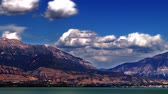 t��o : Time-lapse shot of mountains by the lake in Utah. This shot was taken during the day from across the lake.