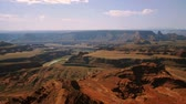halott : Lookout over Dead Horse Point as sun shines over beautiful canyons, valleys, cliffs mesas and Green River below.