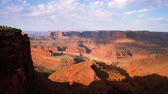árnyék : Lookout over Dead Horse Point as sun rises over beautiful canyons, valleys, cliffs, mesas and Green River below. Stock mozgókép