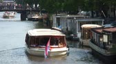 little : Shot of a tour boat driving in Amsterdam