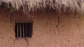 bouda : Close up of window in mud and grass hut
