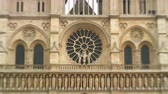 tower : Zoom out from the west rose window of the Notre Dame Cathedral in Paris, France. Stock Footage