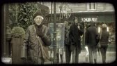 jaleco : Ordinary people, dressed warmly in coats and jackets and hats, walk along Viennese street by buildings and street lamps in Vienna, Austria during winter. Vintage stylized video clip. Vídeos
