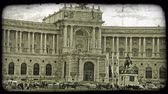 bayrak : A shot of a Vienna building with carriages and vehicles out front. Vintage stylized video clip.