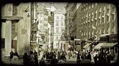 купить : Shot of people walking down a Vienna street lined with shops. Vintage stylized video clip.