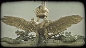 viyana : Shot of a Statue atop a building in Vienna. Vintage stylized video clip. Stok Video