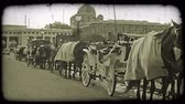 viyana : Panning shot of a line of Carriages in Vienna. Vintage stylized video clip.